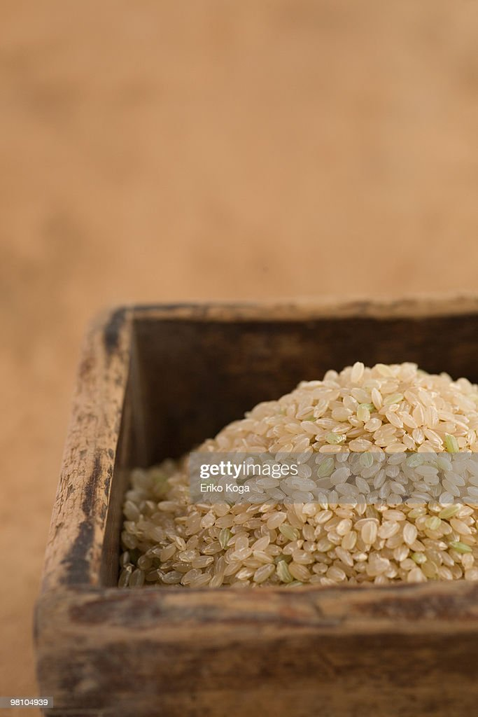 Unpolished rice in wooden box : Stock Photo