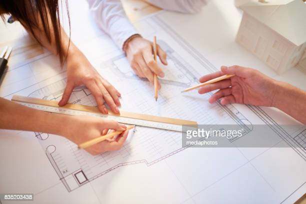 Unrecognizable Architects at Work