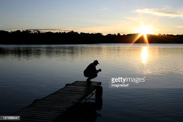 Unrecognizable Caucasian Male Praying By Lake