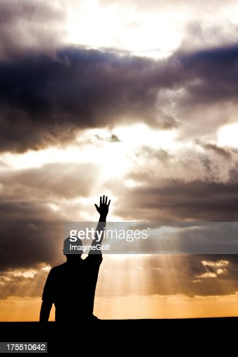 Unrecognizable Male Lifting Hand in Praise and Worship