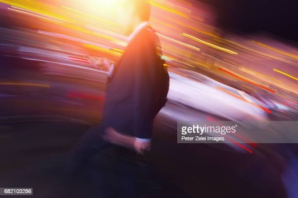 Unrecognizable motion blurred businessman in the lights of London