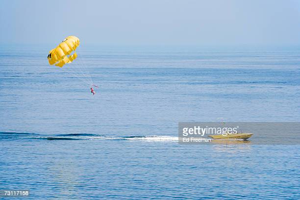 Unrecognizable person parasailing over sea, Albufeira, Algarve, Portugal