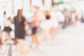 filtered blur abstract people background, unrecognizable silhouettes of people walking on a street