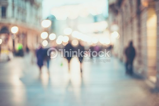 unrecognizable silhouettes of people walking on a street : Stock Photo