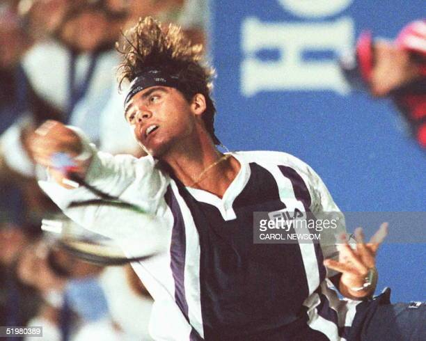 Unseeded Australian Mark Philippoussis follows through on a serve during his fourth round match with topseeded Pete Sampras at the US Open 03...