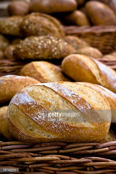 Unsliced loaves of bread in a basket