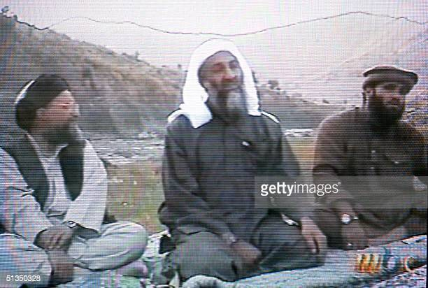 This frame grab from the Saudiowned television network MBC shows alleged terror mastermind Osama bin Laden sitting between his Egyptian lieutenant...