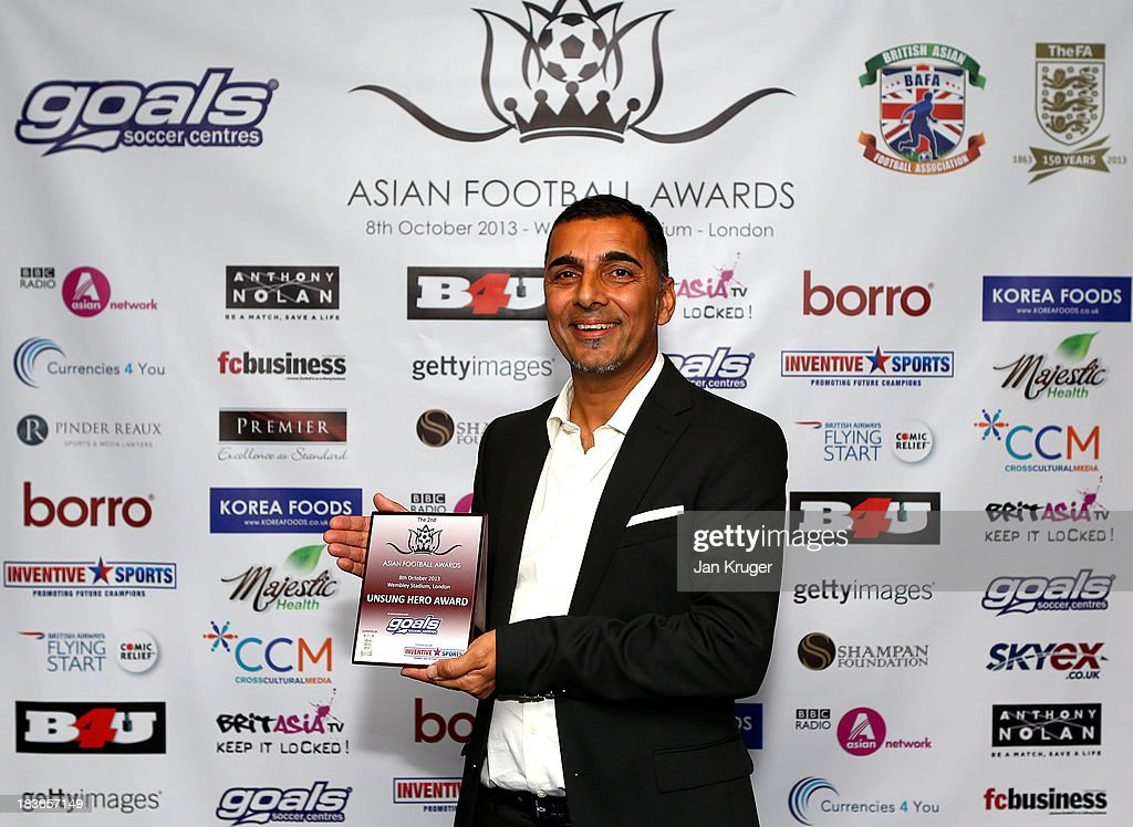Unsung Hero Award winner Butch Fazal poses during the Second Annual Asian Football Awards at Wembley Stadium on October 8, 2013 in London, England.