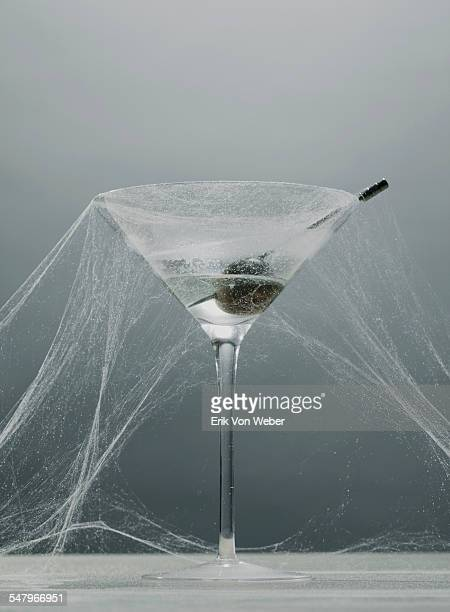 untouched martini glass with cobwebs