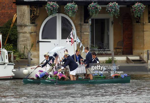Unusal boats row down the Thames during day four of the Royal Henley Regatta Henley on Thames