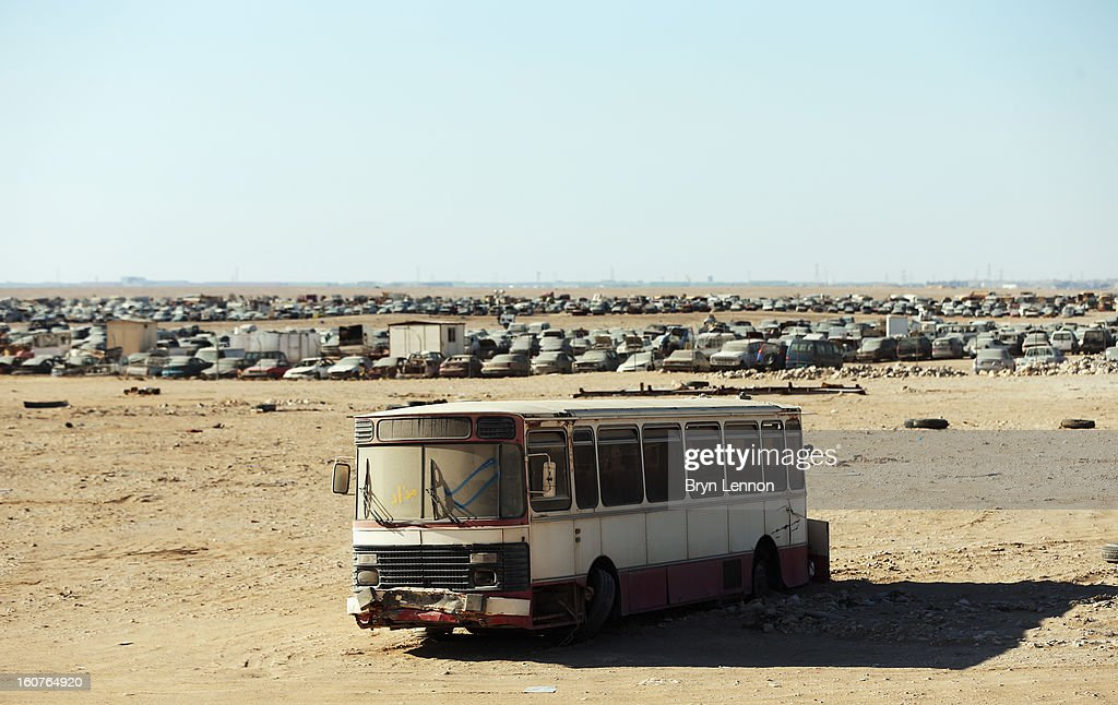 Unused cars and buses are seen abandoned in the desert during stage three of the Tour of Qatar from Al Wakra to Mesaieed on February 5, 2013 in Doha, Qatar.