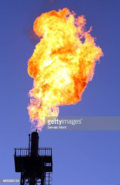 Unused gas burns out of a flare bleeder in Petrochina's Tazhong oil factory on October 12 2006 in Tarim Oilfield Xinjiang province China PetroChina...