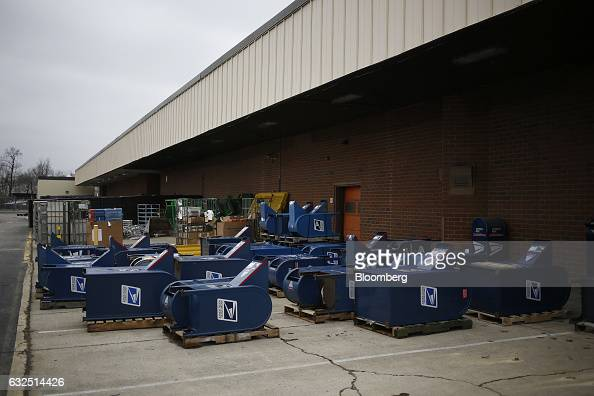 Unused mail drop boxes sit behind a loading dock at the United States Postal Service sorting center in Louisville Kentucky US on Friday Jan 13 2017...