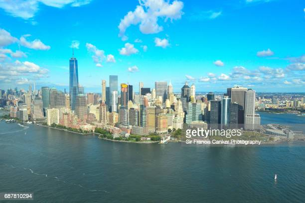 Unusual aerial view of Lower Manhattan with Freedom Tower, Battery Park, Hudson river and financial district in New York City, USA
