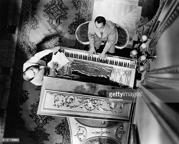 Unusual photograph of Rodgers and Hart working out tune at the piano Undated BPA2