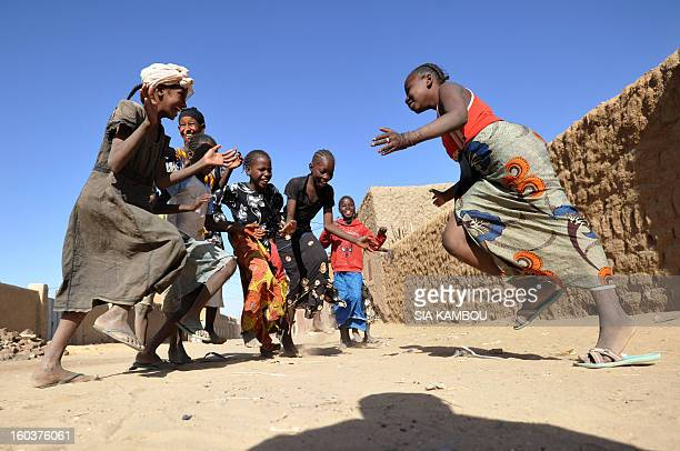 Unveiled Malian girls sing and play on January 30 2013 in the northern city of Gao a key Islamist stronghold until it was retaken on January 26 by...