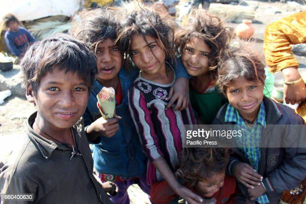 Unwashed children of migrant broom makers during their idle timeBroom makers live in unhygienic conditions because less resources available to...