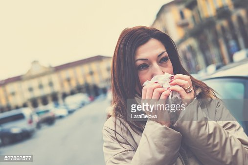 Unwell mature woman on the street