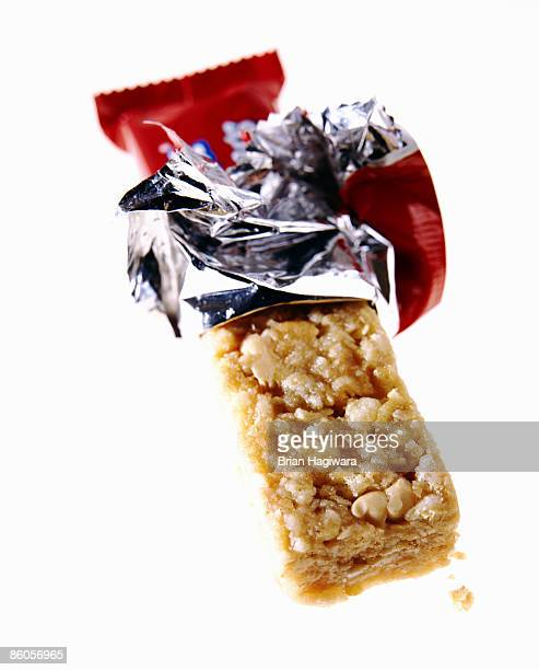 Unwrapped granola bar on white