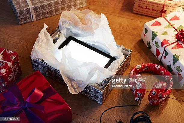 Unwrapped Xmas present revealing tablet
