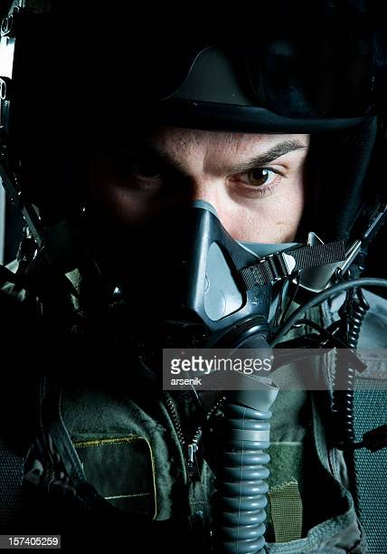 Up close military fighter pilot with oxygen mask