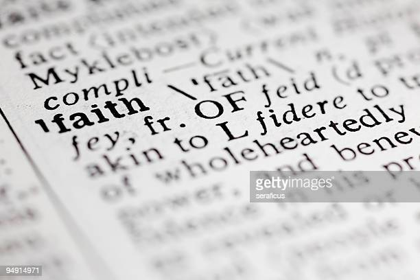 Up close photo of the word faith in the dictionary