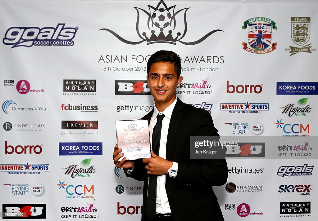 Up & Coming Award winner Yan Dhanda poses during the Second Annual Asian Football Awards at Wembley Stadium on October 8, 2013 in London, England.
