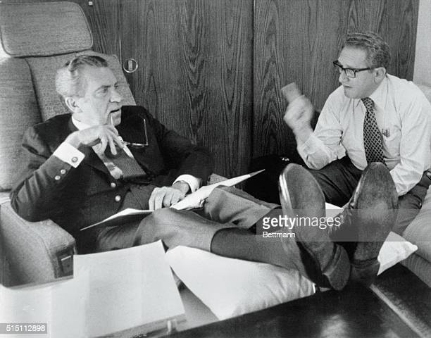 Up in the Air Undated President Richard Nixon and Secretary of State Henry Kissinger confer aboard Air Force One as it heads towards Brussels Belgium...