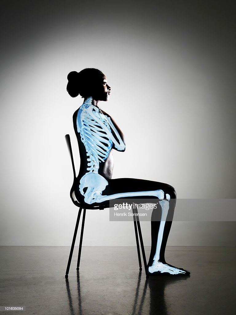 Up right sitting female with skeleton visible : Stock Photo