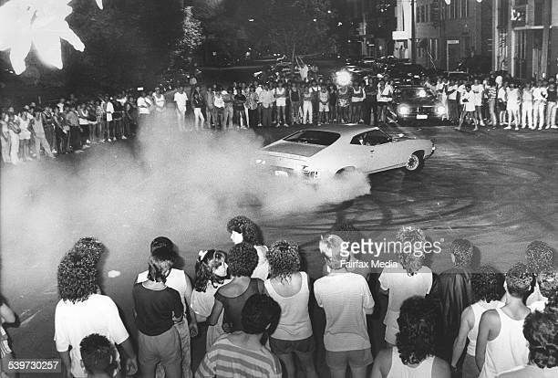 Up to 1000 people gather at the corner of Cardigan and Pelham Streets in Carlton Melbourne to watch the hotted up cars do wheelies and burnouts 7...