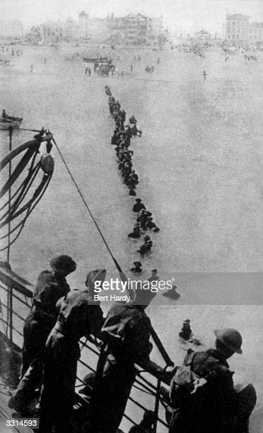 Up to their necks in water retreating soldiers have to struggle through the sea because the waiting ships could not get closer to the Dunkirk beach