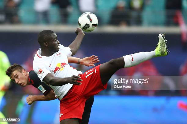 Upamecano of Leipzig and Janik Haberer of Freiburg compete for the ball during the Bundesliga match between RB Leipzig and SC Freiburg at Red Bull...