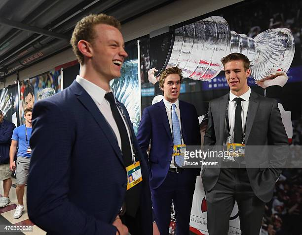 Upcoming NHL draft picks Jack Eichel Connor McBride and Noah Hanafin take part in a photo opportunity at United Center on June 8 2015 in Chicago...