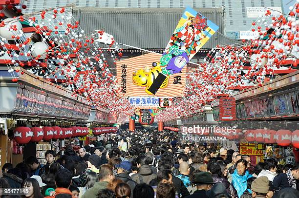 Upcoming 'Year of the Tiger' decorations are displayed at the Nakamise shopping mall in front of Sensoji temple crowded with yearend shoppers in...