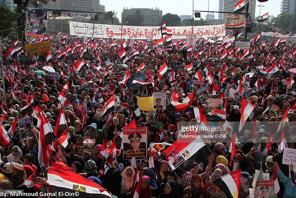 CONTENT] Updates - Egypt, July 26, 2013** Millions of Egyptians protested across Egypt, even before they broke their fast, after General Abd El Fattah El Sisi, Minister of Defense called for people to give a mandate to the Police and Armed Forces to fight terrorism and violence. The call was met with great support from the secular-political front on the same day. The popular support came after the Muslim Brotherhood and Former President, Mohamed Morsi's supporters have been cutting main streets across Cairo, killing many in different cities in the country, found torturing people to death in Rabaa sit-in, and making terrorist attacks in Sinai for a month. The protests that started at midday turned in a celebratory carnival after sunset amid great presence of police and armed forces, especially in the entrances of Tahrir Square and the vicinity of the Presidential Palace in Heliopolis, to secure the protesters. On the other hand, MB and Morsi supporters marched peacefully in tens of thousands across the country in what they called 'The Day of Discernment', army helicopters threw Egyptian flags at them. Yet violence still erupted in Alexandria and Damietta between both sides, while in Shubra, Cairo sectarian violence also took place. In an unusual reaction since June 30, the police have tried to disperse the clashes in Alexandria that left many dead and more than 140 injured. Birdshot and live ammunition as well as rocks and knives were used by both sides. A short while later the police and army were nowhere to be found and left the people again to confront each other. Rage also increased on the Islamist front after news that Morsi was arrested and will be taken to Tora prison have been confirmed. The ousted president is held over allegations of planning with Hamas to attack jails during January 25 Revolution and is to be kept in prison for questioning for the next 15 days.