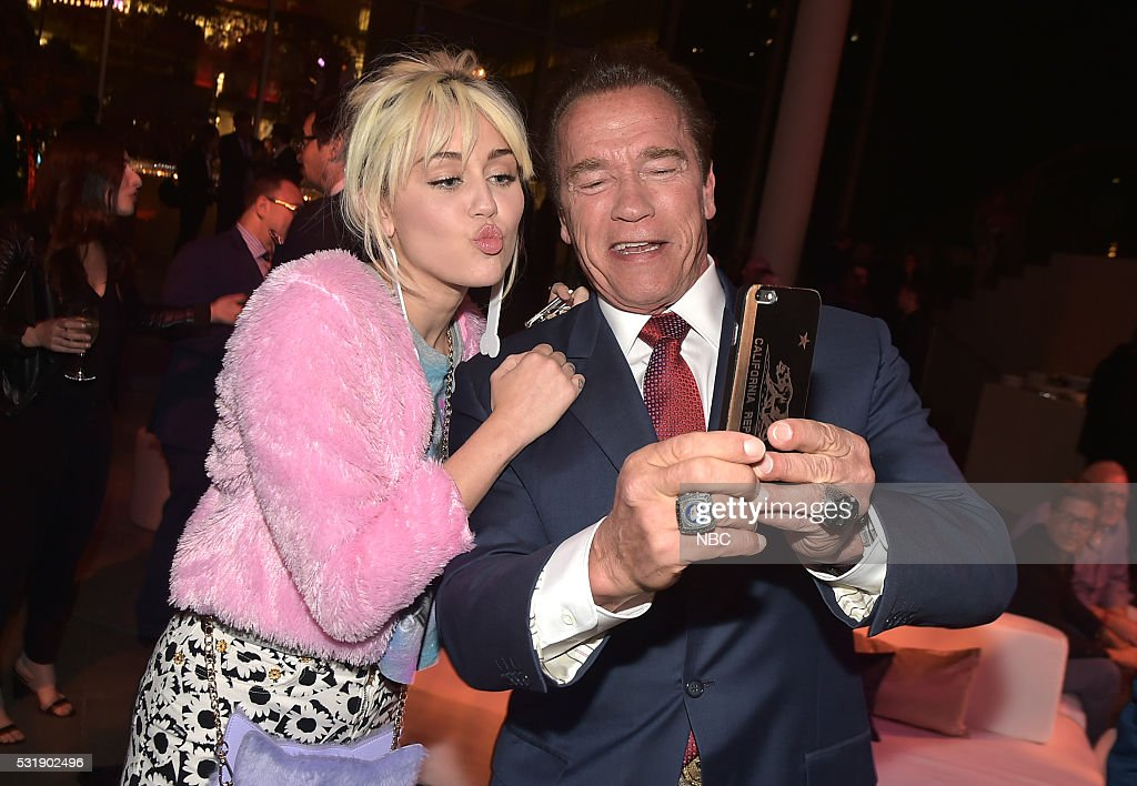 Upfront Party at MoMA in New York City on Monday, May 16, 2016' -- Pictured: (l-r) <a gi-track='captionPersonalityLinkClicked' href=/galleries/search?phrase=Miley+Cyrus&family=editorial&specificpeople=3973523 ng-click='$event.stopPropagation()'>Miley Cyrus</a>, 'The Voice' on NBC; <a gi-track='captionPersonalityLinkClicked' href=/galleries/search?phrase=Arnold+Schwarzenegger&family=editorial&specificpeople=156406 ng-click='$event.stopPropagation()'>Arnold Schwarzenegger</a>, 'The New Celebrity Apprentice' on NBC --