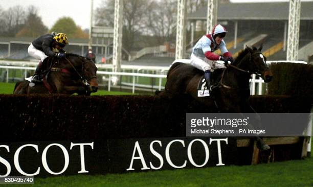 Upgrade with jockey Tony McCoy jumps the last fence to win the First National Gold Cup Chase from second placed Bellator and jockey Norman Williamson...
