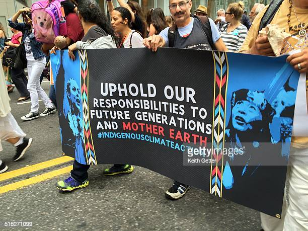 'Uphold Our Responsibilities to Future Generations and Mother Earth ' Banner carried by marchers at People's Climate March New York City September 21...
