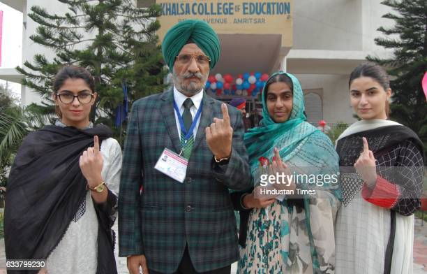 Upkar Singh Sandhu Aam Aadmi Party Lok Sabha bypoll election candidate with his family members showing his inked fingers after casting his vote out...