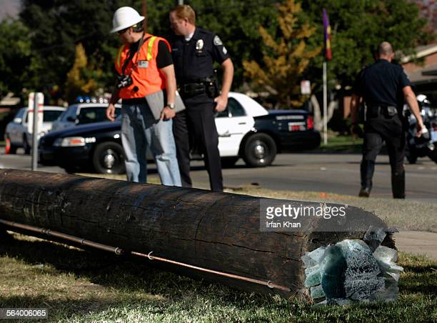 Upland Dec 07 2006 A utility pole with a piece of car windshield sticking to it lies on the ground as Cal/OSHA and Upland police investigate the...