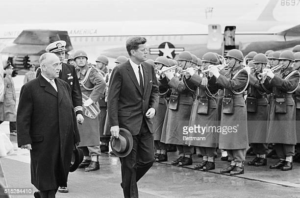 Upon arrival early June 3rd US President John F Kennedy inspects honor guard at Schwechat Airport He is accompanied by Austrian President Adolf...