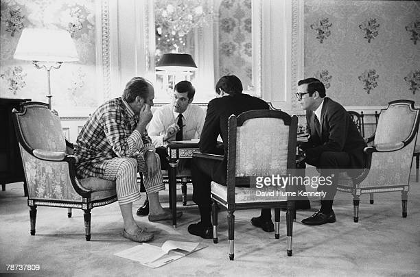 Upon arriving in Japan in November 1974 President Ford holds a meeting in Tokyo's Akasaka Palace State Guest House with his staff Military Aide Steve...