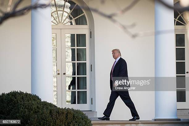Upon returning from Philadelphia US President Donald Trump walks along the West Wing Colonnade on his way to the Oval Office at the White House...