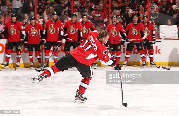 Upon signing a one day contract to retire with the NHL team he played 17 years with Daniel Alfredsson of the Ottawa Senators takes part in warmup...