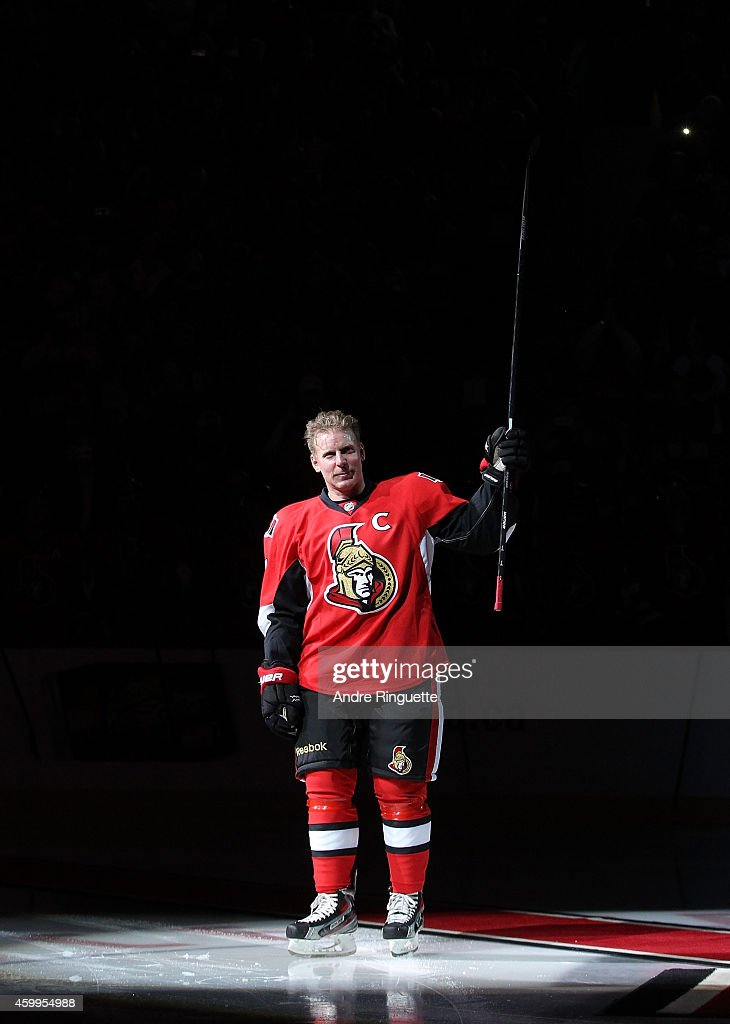 Upon signing a one day contract to retire with the NHL team he played 17 years with Daniel Alfredsson of the Ottawa Senators salutes the fans during...