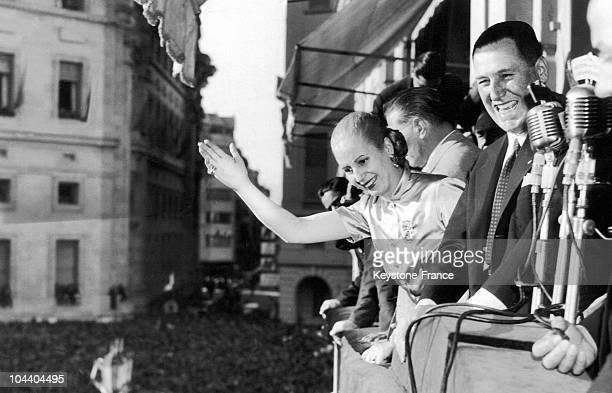 Upon the 5th anniversary of the Peronist movement in Buenos Aires Argentinian President Juan PERON and his wife Eva PERON hail the crowd from the...