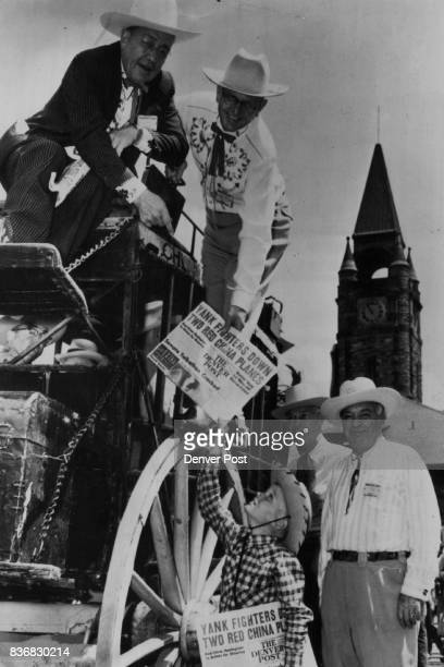 Upon the train's arrival in Cheyenne newsboy Delbert Bell sells a copy of The Denver Post to Palmer Hoyt editor and publisher of The Post and boss...