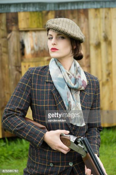 Upper class Engish lady ready to go shooting
