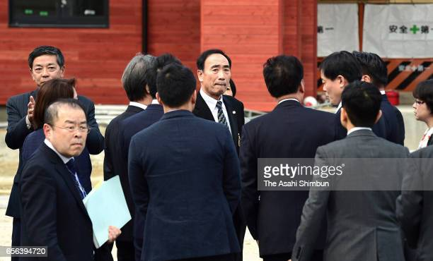 Upper House Budget Committee members inspect a site with Moritomo Gakuen head director Yasunori Kagoike at the school operator bought from government...