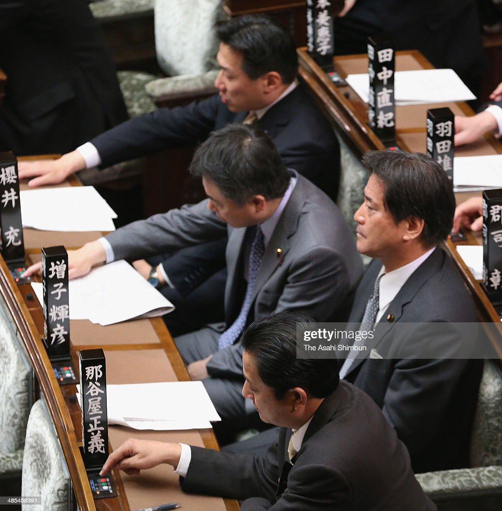 Upper house lawmaker Teruhiko Mashiko (2nd fro the bottom), whose constituency is Fukushima prefeture, of Democratic Party of Japan abstains the vote while other Upper house lawmakers vote in the pact that allow for the export of the Japan's nuclear technology to Turkey and the United Arab Emirates during a plenary session of the upper house on April 18, 2014 in Tokyo, Japan.